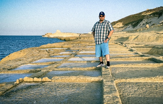 Storyboard artist in salt pond on Malta